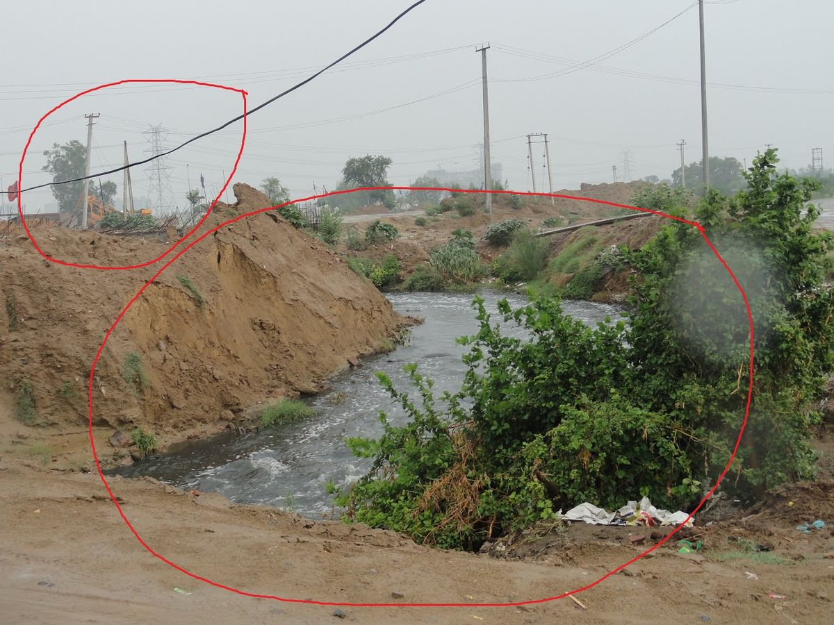 Gurgaon Sector 103(New Sectors) a natural drain about to be blocked. This is the reason why Gurgaon