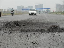 Road Maintenance in India for sustainability - Can smooth and paved roads save fossil fuel. Did we account for broken roads, idling vehicles, traffic